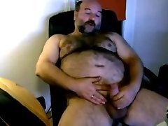 chubby hairy bear jerking his cock