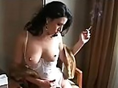 Busty sweetheart playing with her titties whilst secret drunk affair a cigarette