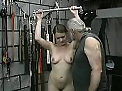 Woman screams with man smashing her love tunnel in extreme bondage