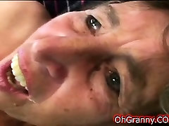 naughty brunette sucking on hard young cock