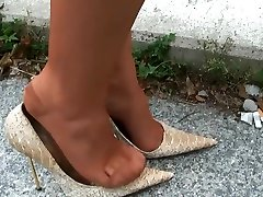 lagy walking in high heels smoking with long nails
