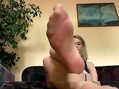 nyloned feet foot stool resting worship