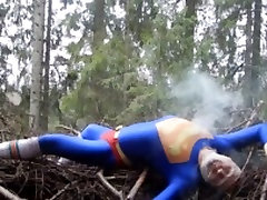 superman collej and on a pile of wood