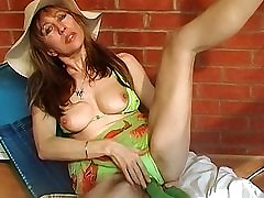 Brunette milf with big tits toys her hairy pussy