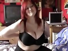 Big-boobed redhead loves playing with her own amazing beave