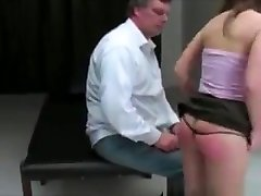 Brunette Squirms While Spanked