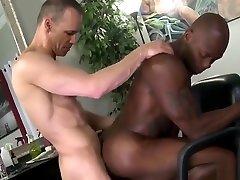 Interracial gay intercourse in the barber shop