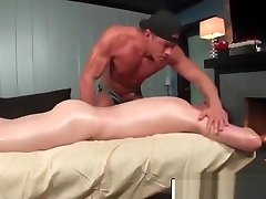 Gays massaging cocks with oil