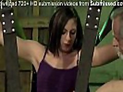 Submissive teen is chained in leather swing by her master