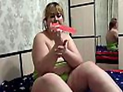 Chubby with fat ass in shorts fucked with dildo doggystyle. Homemade masturbation.