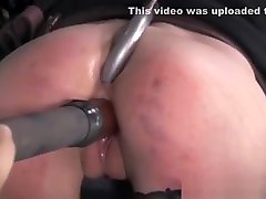 Restrained Tattooed Sub Caned In Dungeon