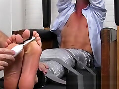 A bound gay guy has foot fetish session with a pervert