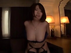 Hot Asian beauty showcases her body while in a sexy lingerie