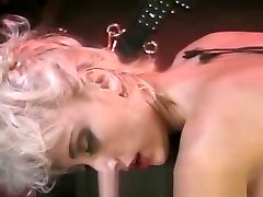 Busty dominatrix surrenders herself to a friend in a sissy first blowjob session