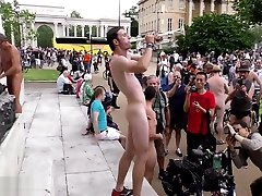 Sexy naked man plays trumpet in mim in tight jeans town square