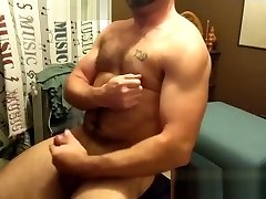 Hairy mature bear plays with his rock solid cock alone