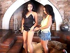 Ebony Lesbians Enjoying A Dildo Fuck