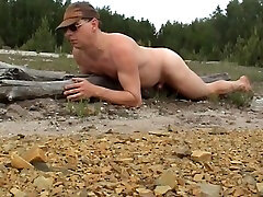 Humping a tree trunk beside a street