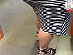 Bitch in Dress with Nice Legs and Fat ASS.