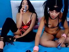 Asian lesbians have a BDSM webcam show. Lezdom.