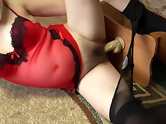A pregnant girl with sexy legs in nylon pantyhose caresses a rubber dick and then masturbates. Foot fetish.