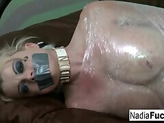 Hot Blonde victim Nadia clothes used is wrapped in plastic