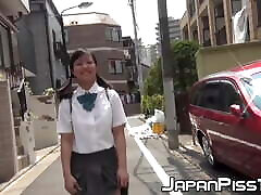 Young Japanese only small amateury pisses her panties outdoor