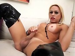 Old tranny Shakira Voguel in high leather boots