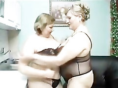 mature ladies play in the kitchen