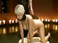 Waxed blonde paddled and flogged in the upper floor