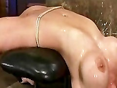 Busty bound and severely arched babe flogged and fingered