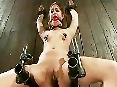 Bound in sitting position caned and machine fucked