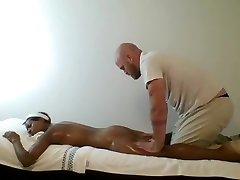 Ebony MILF massaged & finger banged by muscled masseur
