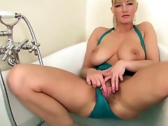 beauty blonde mature, big tits masterbates her hairy pussy