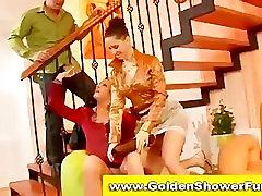 Pissing golden shower fetish threesome