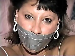 Native American model Trish tape gagged and tied up