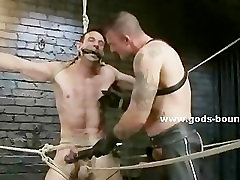 Gay slaves tied one by another in chains and cuffs naked are forc