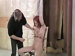 Wasteland Original BDSM: Slave girl bound on a steaemer trunk