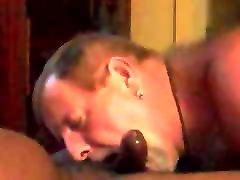 Daddy bear sucking a black cock