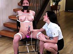 Lesbian MILF having fun with a busty brunette patient