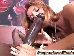 Mature redhead sucks black dick