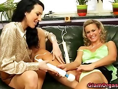 Glamorous clothed lesbians lick and use toys on their wet pussies
