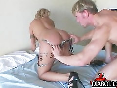 Blonde takes pole up her ass hole