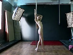Hot pole dancing show performed by hol open and charming Christina Toth