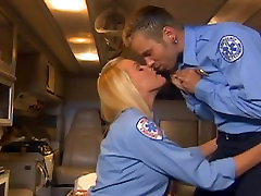 Uniformed babe in stockings and a garter fucking in an ambulance