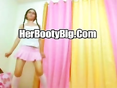 Sexy Asian Babe In Glasses And Pink Skirt Dancing On WebCam