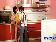 sexy young brunette in the hot kitchen