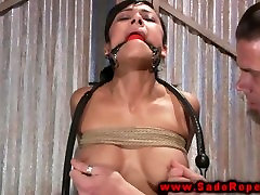 BDSM slave tied and bound for her strict master