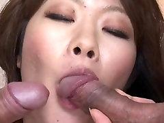 Mature asian milf sucks on two hard cocks