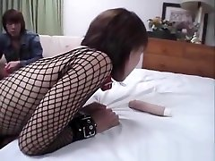 Young Asian brunette doll caught in BDSM